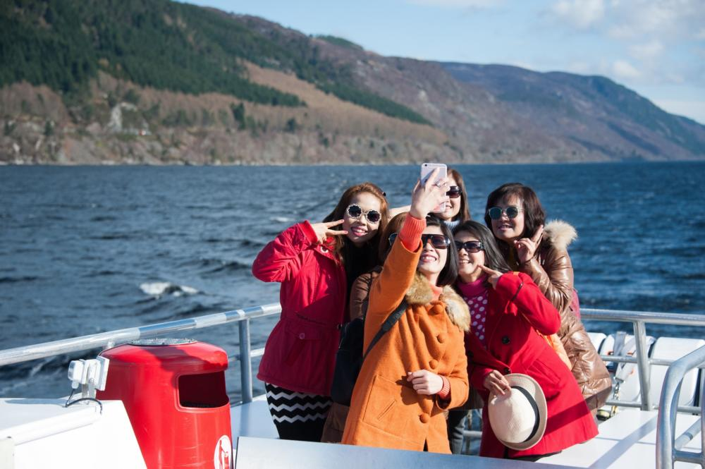 Chinese Visitors enjoy the Loch Ness by Jacobite Experience