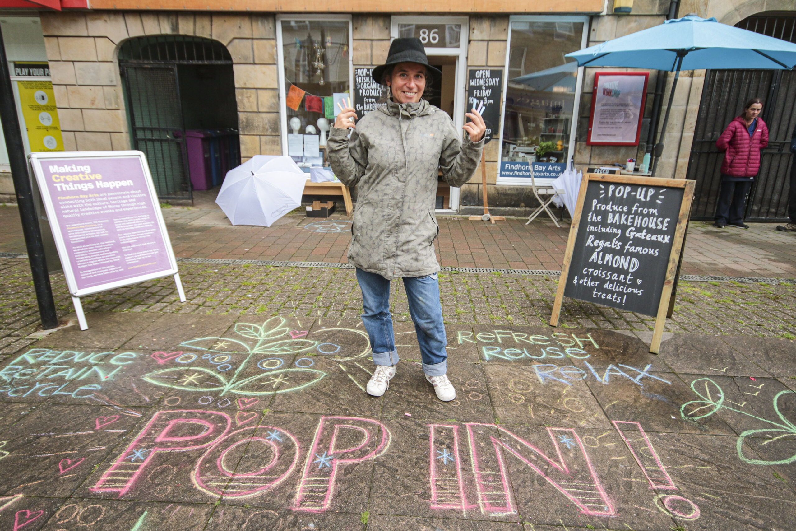 Artist Rosie Balyuzi puts her mark on the street in the town square outside 86 High Street. Pic: Marc Hindley